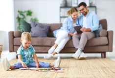 Happy family mother father and child son draw together at home stock photo