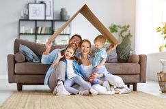 Happy family mother father and child son  draw together at home royalty free stock images