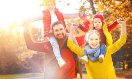 Happy family mother, father and children on an autumn walk. In park Stock Images