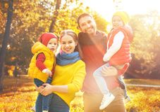 Happy family mother, father and children on an autumn walk Royalty Free Stock Photography