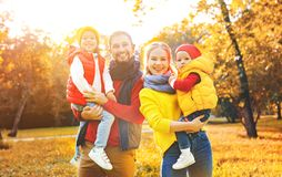 Happy family mother, father and children on an autumn walk Stock Images