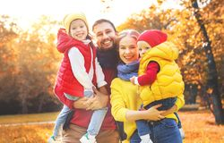 Happy family mother, father and children on an autumn walk. In park Stock Photo