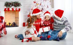 Happy family mother father and children on Christmas morning Stock Photos