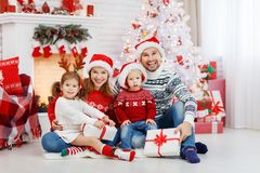 Happy family mother father and children on Christmas morning Stock Photo