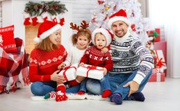 Happy family mother father and children on Christmas morning Royalty Free Stock Image