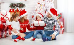 Happy family mother father and children on Christmas morning Royalty Free Stock Photography