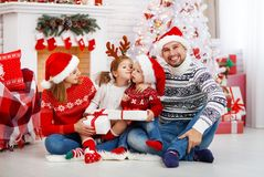 Happy family mother father and children on Christmas morning. Happy family mother father and children at home on Christmas morning Royalty Free Stock Photos