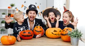 Happy family mother father and children in costumes   on  Hallow Stock Photos
