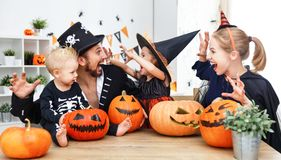 Happy family mother father and children in costumes   on  Hallow Stock Images