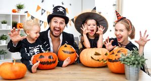 Happy family mother father and children in costumes   on  Hallow Royalty Free Stock Photo