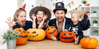 Happy family mother father and children in costumes   on  Hallow Stock Photography