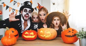 Happy family mother father and children in costumes and makeup o. N a celebration of Halloween stock image