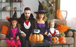 Happy family mother father and children in costumes and makeup o stock image