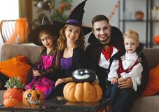 Happy family mother father and children in costumes and makeup o stock photo