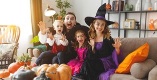 Happy family mother father and children in costumes and makeup o royalty free stock images