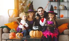 Happy family mother father and children in costumes and makeup o royalty free stock photos