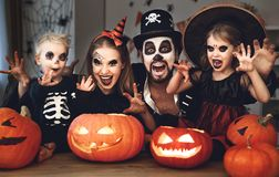 Happy family mother father and children in costumes and makeup o Stock Photos