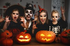 Happy family mother father and children in costumes and makeup o Royalty Free Stock Photo