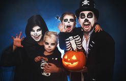 Happy family mother father and children in costumes and makeup o stock photography