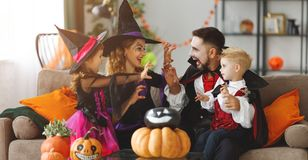 Happy family mother father and children in costumes and makeup o stock images