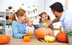Happy family mother father and children cut pumpkin for   hallow Royalty Free Stock Photography