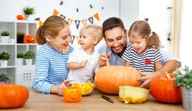 Happy family mother father and children cut pumpkin for   hallow Stock Images