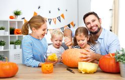 Happy family mother father and children cut pumpkin for   hallow Royalty Free Stock Photos