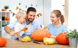 Happy family mother father and children cut pumpkin for   hallow Royalty Free Stock Image