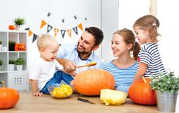 Happy family mother father and children cut pumpkin for   hallow Stock Photo