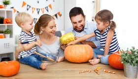 Happy family mother father and children cut pumpkin for   hallow Royalty Free Stock Images