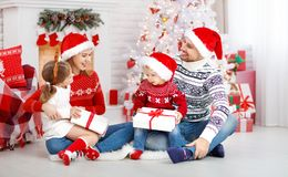 Happy family mother father and children on Christmas morning Royalty Free Stock Photos