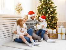 Family mother father and children at home on Christmas morning. Happy family mother father and children at home on Christmas morning Royalty Free Stock Photography