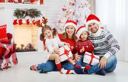 Happy family mother father and children on Christmas morning. Happy family mother father and children at home on Christmas morning Stock Images