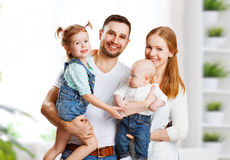 Happy family mother, father and children at home. Happy family mother, father and two children at home Royalty Free Stock Photography