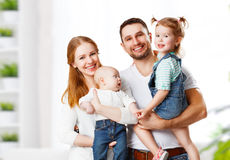 Happy family mother, father and children at home. Happy family mother, father and two children at home Stock Photo