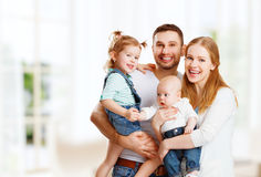 Happy family mother, father and children at home. Happy family mother, father and two children at home Stock Images