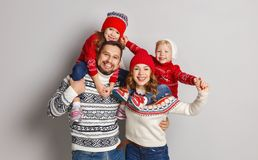 happy family mother, father and children in knitted hats and sweaters on gray background stock photos
