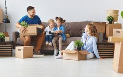 Happy family mother father and children move to new apartment an stock image