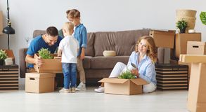 Happy family mother father and children move to new apartment an stock photography