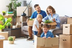 Happy family mother father and children move to new apartment an royalty free stock photography