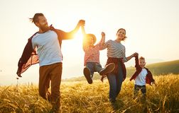 Free Happy Family: Mother, Father, Children Son And Daughter On Sunset Stock Image - 150794881