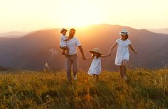 Happy family: mother, father, children son and daughter on sunse. Happy family: mother, father, children son and  daughter on nature  on sunset Stock Images