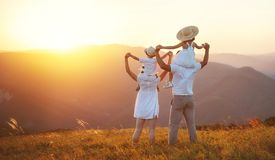 Happy family: mother, father, children son and daughter on sunse Stock Image