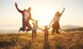 Happy family: mother, father, children son and daughter on sunse Royalty Free Stock Images