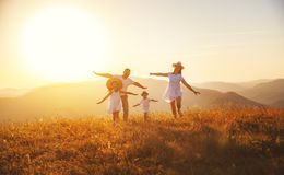 Happy family: mother, father, children son and daughter on sunse. Happy family: mother, father, children son and daughter on nature on sunset stock image