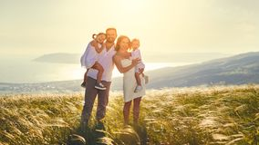 Happy family: mother, father, children son and daughter on sunse Stock Photos