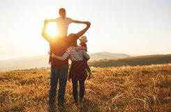 Happy family: mother, father, children son and daughter on sunse. Happy family: mother, father, children son and daughter on nature on sunset royalty free stock photography