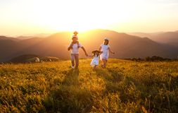 Happy family: mother, father, children son and daughter on sunset stock photo