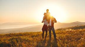 Happy family: mother, father, children son and daughter on sunset royalty free stock image