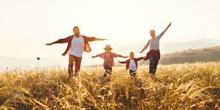 Happy family: mother, father, children son and daughter on sunset royalty free stock photos